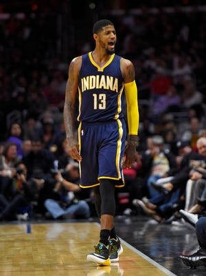 Indiana Pacers forward Paul George celebrates after hitting a three point shot during the second half of an NBA basketball game against the Los Angeles Clippers, Wednesday, Dec. 2, 2015, in Los Angeles. The Pacers won 103-91. (AP Photo/Mark J. Terrill)
