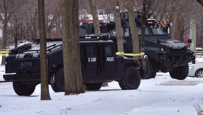 Police vehicles parked Thursday at a house on the 200 block of Fourth Avenue Northeast in St. Cloud. Police requested assistance from the Minneapolis Bomb Squad.