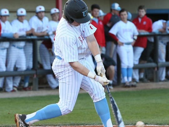 USJ batter Seth Rohlwing hits a low pitch Tuesday evening