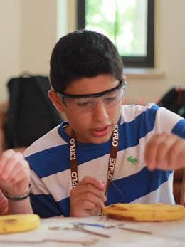 Francisco Vazquez practices sutures in a banana peel. Vazquez was accepted to the Explo Ortho summer program on the campus of Wellesley College this past summer.