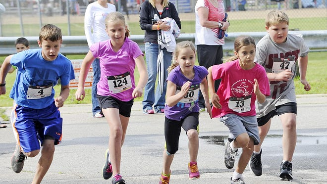 Children participate in the North Fondy Fest Run/Walk in 2013.