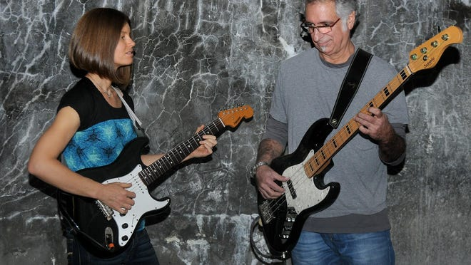 The Compact, featuring guitarist Erin Hobson and bass player Steven W. Ross.