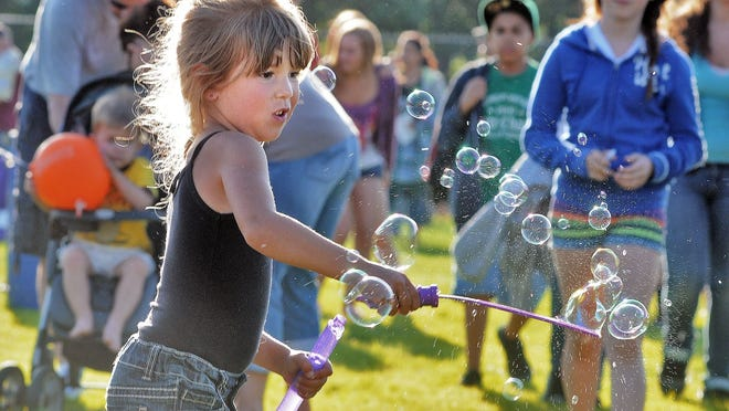 A girl creates some beautiful bubbles at a previous Starburst at Doyle Field in Leominster. This year's event has been moved to August because of the COVID-19 pandemic.