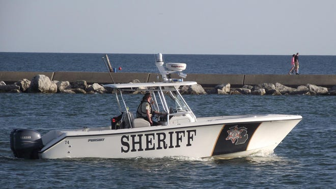 The Ottawa County Sheriff's Office Marine Patrol in the channel linking Lake Macatawa with Lake Michigan on Thursday, May 29, 2014. Jim Hayden/Sentinel staff