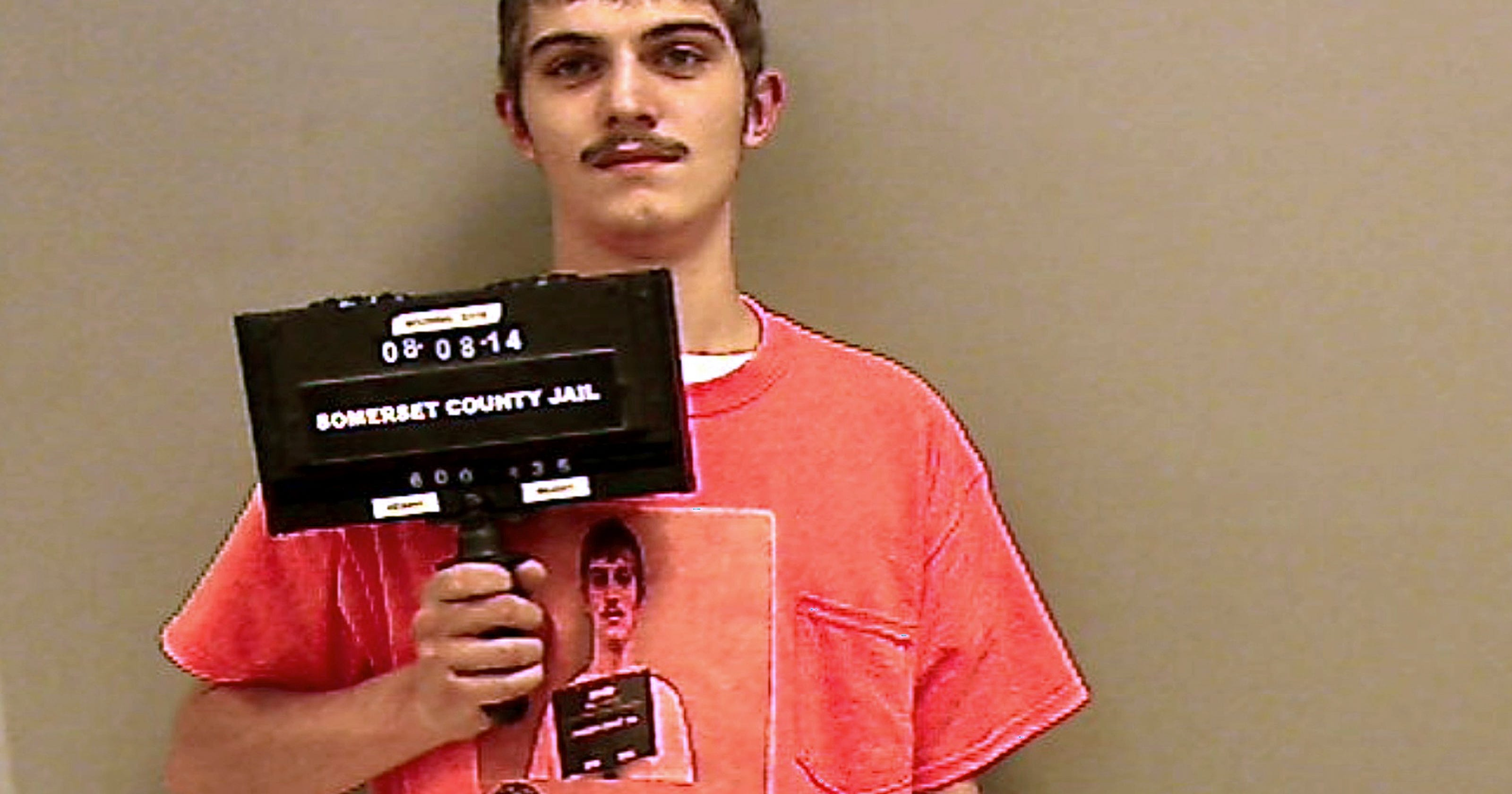 Meta mug: Man wears mug shot shirt for jail booking photo