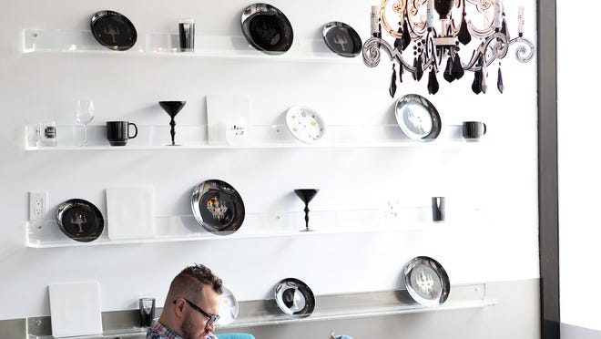 A man reads a magazine inside Plate | Glass in Palm Springs, Calif. on Thursday, January 29, 2015. The restaurant held a VIP tasting to introduce media and other people to their menu.