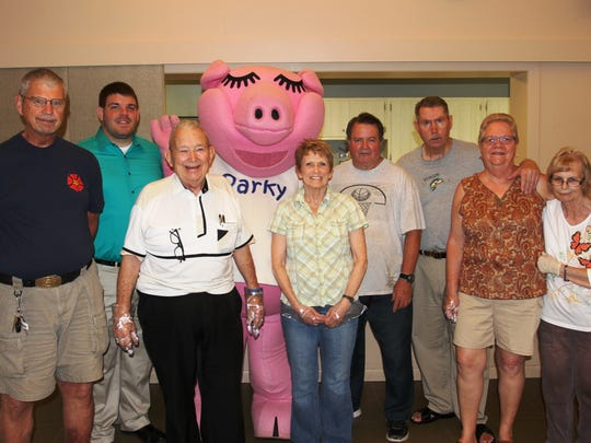 The people who run Pataskala Church of the Nazarene's Kids Eat Free program contend the program would not be successful without the help of volunteers and local support. On a recent Thursday, some of the volunteers posed for a picture with Rick Friend, the assistant manager at the Pataskala Park National Bank branch and Parky, Park National Bank's mascot. The branch donated the day's lunch.