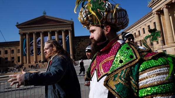 Philadelphia Eagles center Jason Kelce, right, arrives in front of the Philadelphia Museum of Art after a Super Bowl victory parade for the Philadelphia Eagles football team, Thursday, Feb. 8, 2018, in Philadelphia. The Eagles beat the New England Patriots 41-33 in Super Bowl 52. (AP Photo/Alex Brandon) ORG XMIT: PAAB125
