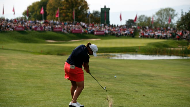 In this Sept. 16, 2018, file photo, Angela Stanford plays an approach shot on the 18th hole during the fourth round of the Evian Championship women's golf tournament in Evian, eastern France. The LPGA Tour has lost its first major because of the COVID-19 pandemic. The tour says the Evian Championship has been canceled this year because of travel and border restrictions in France.