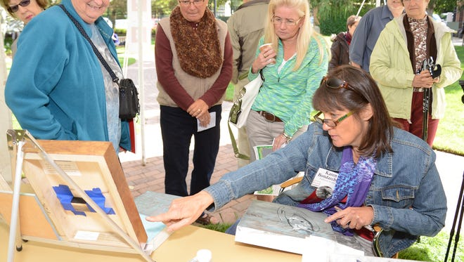 "Karen Bondarchuk particpates in Artists in Action during the 2015 ""Birds in Art"" opening weekend festivities at the Woodson Art Museum."