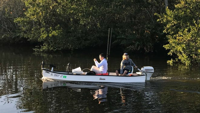 Jesse Capwell, 15, left, and A.J. Chew, 13, right, both of Palm City, get ready to go fishing last month in the St. Lucie River aboard Chew's gheenoe.