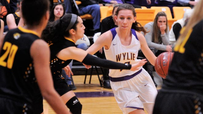 Wylie's Abbey Henson drives the lane during the first half against Snyder on Friday, Jan. 12, 2018 at Bulldog Gym.