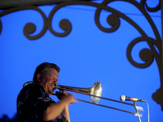 Tim Streagle plays a trombone solo during the concert