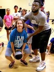 MTSU Men's basketball player Giddy Potts helps Sarah