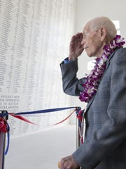 John Anderson visits the memorial at Pearl Harbor on Dec. 7, 2014. A wall there bears the names of those killed, including Anderson's twin brother.
