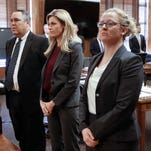 Sportscaster and television host Erin Andrews, center, stands as the jury enters the courtroom Wednesday, March 2, 2016, in Nashville. Attorney Scott Carr is on the left.