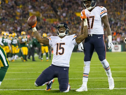 Bears receiver Brandon Marshall (15) celebrates his 23-yard touchdown catch during the first quarter against the Packers in Green Bay.