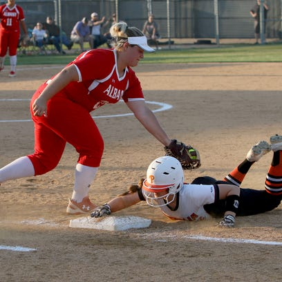 Petrolia's Kelsie Whalen slides back to first to avoid