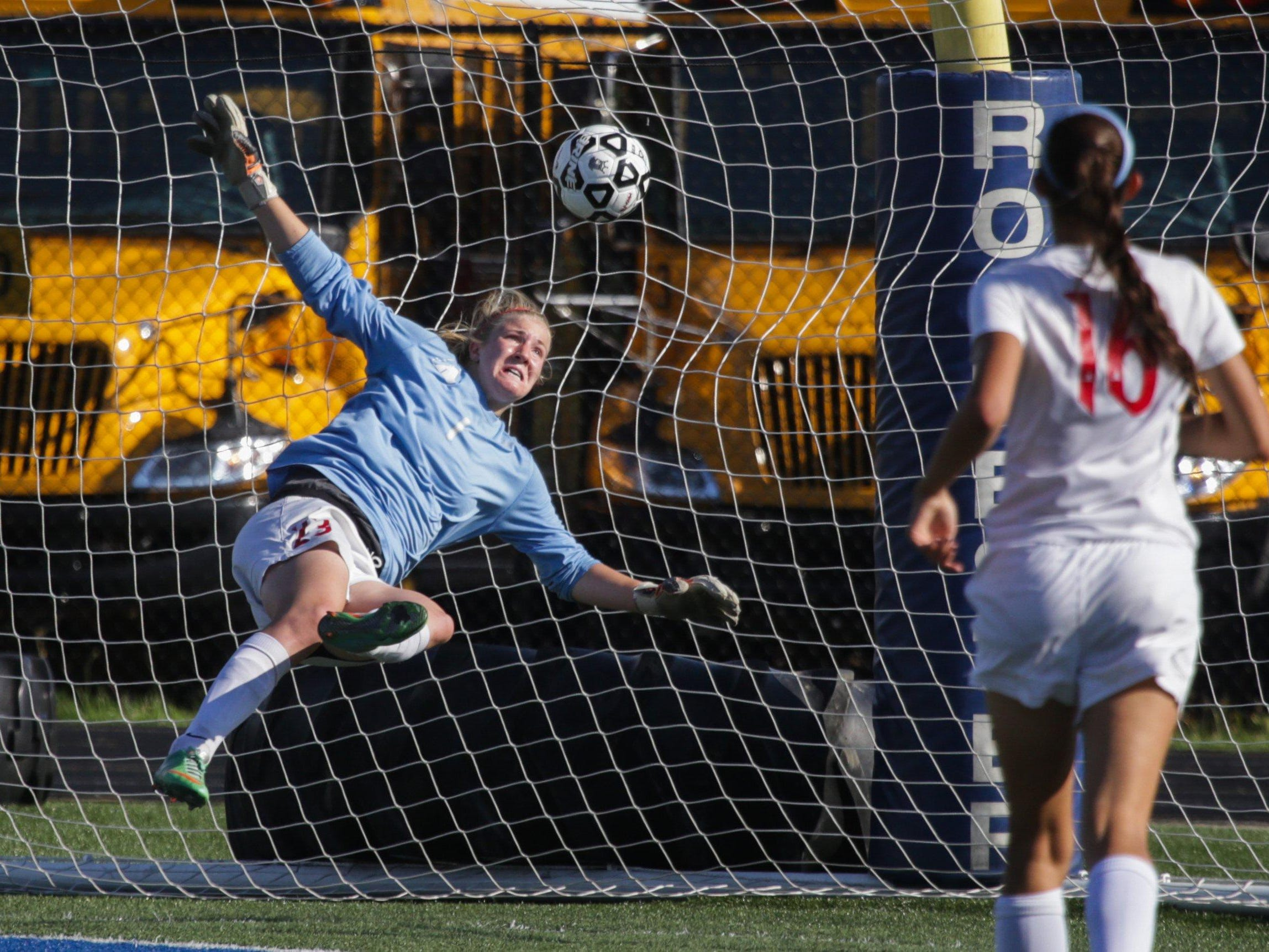 Troy Athens goalie Amanda Harris is unable to save this shot from Grand Blanc's Morgen Metzger during their Division 1 semifinal Wednesday.