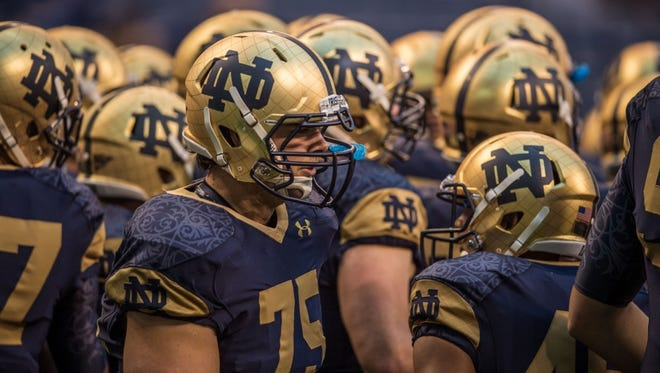 Notre Dame showed off an updated look to their helmets at Lucas Oil Stadium for the Shamrock Series vs. Purdue.