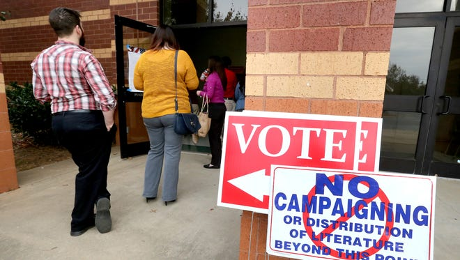 This file photo from Nov. 8, 2016, shows voters lining out the door to vote early on Election Day at Barfield Elementary School in Murfreesboro.