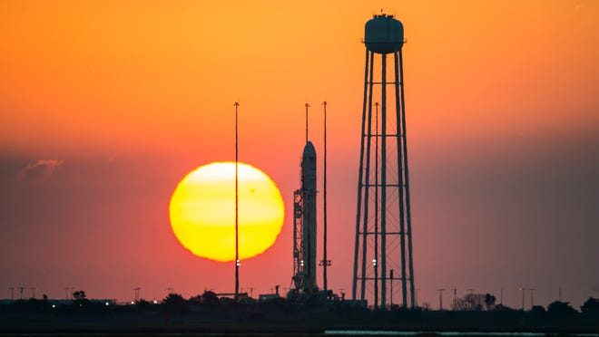 In this photo provided by NASA, the Orbital Sciences Corporation Antares rocket, with the Cygnus spacecraft onboard, is seen on launch Pad-0A during sunrise, Sunday, Oct. 26, 2014, at NASA's Wallops Flight Facility in Virginia. The Antares will launch Monday, Oct. 27 with the Cygnus spacecraft filled with over 5,000 pounds of supplies for the International Space Station, including science experiments, experiment hardware, spare parts, and crew provisions. The Orbital-3 mission is Orbital Sciences' third contracted cargo delivery flight to the space station for NASA. (AP Photo/NASA, Joel Kowsky)