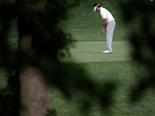 Bubba Watson putts on the 12th hole during a practice round for the PGA Championship golf tournament at Valhalla Golf Club on Tuesday, Aug. 5, 2014, in Louisville, Ky. The tournament is set to begin on Thursday. (AP Photo/David J. Phillip)