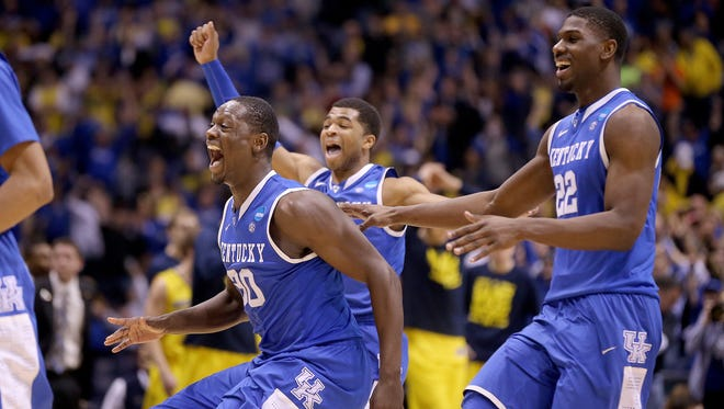 KentuckyÕs Julis Randle and Alex Poythress,right, celebrate their win. Kentucky defeated Michigan 75-72 in the NCAA Division1 Men's Basketball Championship Midwest Regional championship game Sunday, March 28, 2014, at Lucas Oil Stadium.