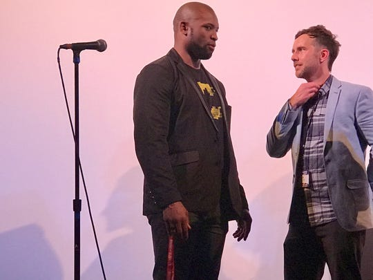 "Former Packers running back Ahman Green, left, talks with ""The 60 Yard Line"" filmmaker Ryan Churchill after Sunday's world premiere at the Wisconsin Film Festival in Madison."
