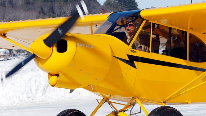 Angela Leedy of Pittstown, N.J., looks for a parking spot after flying three hours to the only ice runway in the Lower 48 states approved by the Federal Aviation Administration on Saturday, Feb. 28, 2015, on Lake Winnipesaukee in Alton, N.H.