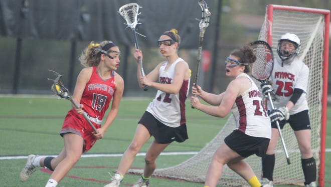 Girls lacrosse action between Nyack and Tappan Zee during the 12th annual Stacey Sennas McGowan Memorial Lacrosse Games at Nyack High School on Saturday, May 7th, 2016.
