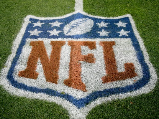 FILE - In this Nov. 12, 2017, file photo, an NFL logo is displayed on the field before an NFL football game between the New England Patriots and the Denver Broncos in Denver. Fox and the NFL have agreed to a five-year deal for Thursday night football games, Fox announced Wednesday, Jan. 31, 2018. Those games previously were televised by CBS and NBC, two of the league's other network partners.  (AP Photo/Jack Dempsey, File)