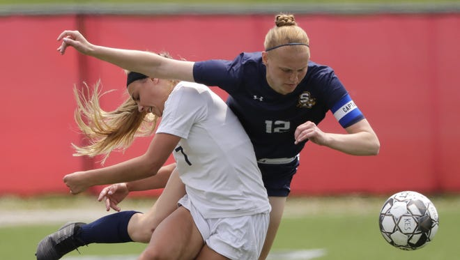 Bay Port High School's McKenzie Johnson (7) is fouled by Sheboygan North High School's Kylie Gierach (12) during their WIAA Division 1 final girls state soccer game Satruday, June 16, 2018, at Uihlein Soccer Park in Milwaukee, Wis.  Dan Powers/USA TODAY NETWORK-Wisconsin