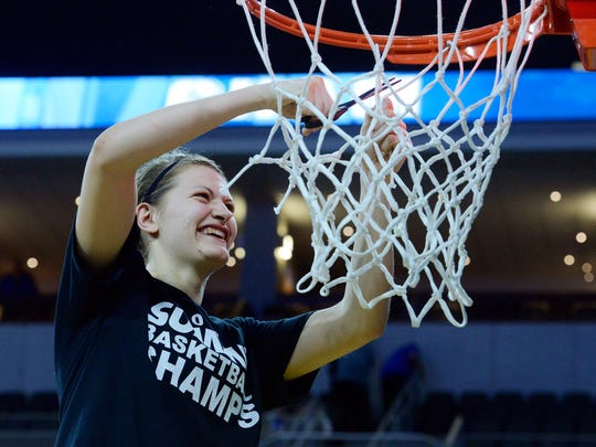 SDSU's Macy Miller cuts down part of the net after