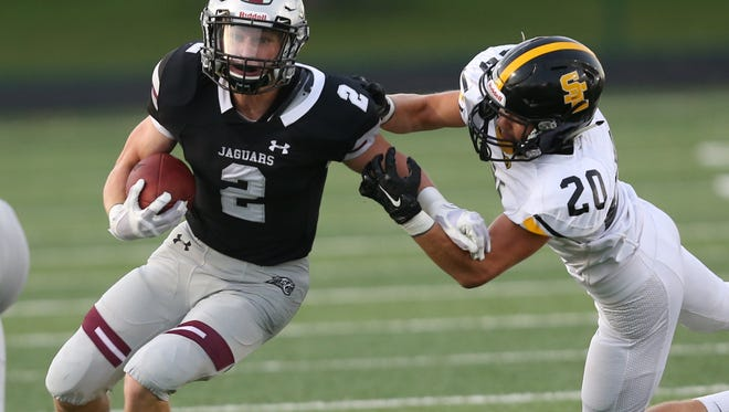 Ankeny Centennial's Jensen Gates is chased down by Southeast Polk's Jonah Quick during a game on Sept. 16 at Ankeny Stadium.