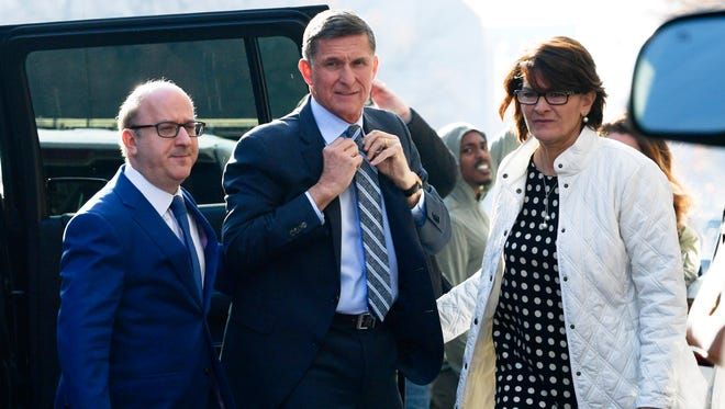 Former Trump national security adviser Michael Flynn, center, arrives at federal court in Washington, Dec. 1, 2017. Court documents show Flynn, an early and vocal supporter on the campaign trail of President Donald Trump whose business dealings and foreign interactions made him a central focus of Mueller's investigation, will admit to lying about his conversations with Russia's ambassador to the United States during the transition period before Trump's inauguration.