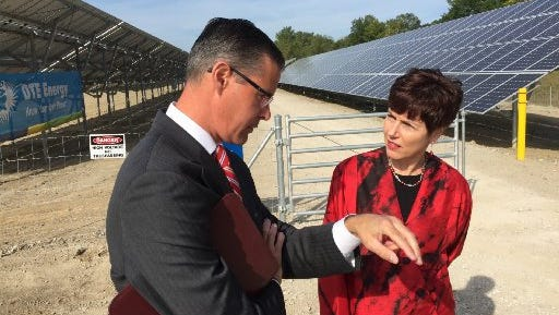 John Petz, Domino's Farms director of public affairs talks to Della DiPietro, Ann Arbor Township's treasurer, about the new solar array that will generate enough electricity to power about 200 homes on Tuesday.