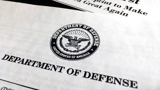 A portion of President Donald Trump's first proposed budget, focusing on the Department of Defense, and released by the Office of Management and Budget, is photographed in Washington on March 15. President Donald Trump is unveiling a $1.15 trillion budget, a far-reaching overhaul of federal government spending that slashes a dozen departments to finance a significant increase in the military and make a down payment on a U.S.-Mexico border wall.