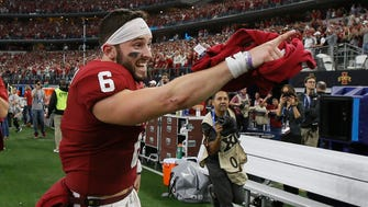 Dec 2, 2017; Arlington, TX, USA; Oklahoma Sooners quarterback Baker Mayfield (6) points to the stands after winning the Big 12 Championship game against the TCU Horned Frogs at AT&T Stadium. Mandatory Credit: Tim Heitman-USA TODAY Sports