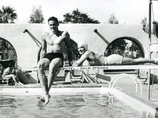 Mr. and Mrs. Errol Flynn (Lili Damita) on diving board