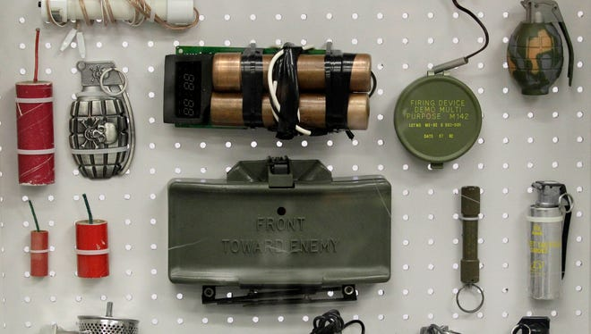 Items confiscated by the Transportation Security Administration are on display at the TSA's training center at Newark Liberty International Airport in this file photo from Nov. 17, 2011. Among the items is a replica M18 claymore mine and a fake dynamite bomb.