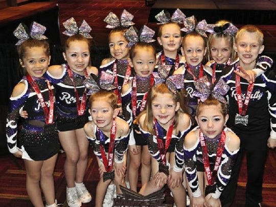 Kings and Queens, a mini-level 1 team , won second place in its division Jan. 16 and 17, 2016, at the Jamfest Cheer Super Nationals in Indianapolis.