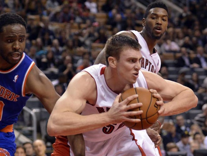 Toronto Raptors power forward Tyler Hansbrough (50) grabs a rebound in the first overtime period of a game against the New York Knicks at the Air Canada Centre. Toronto won the game in triple overtime123-120.