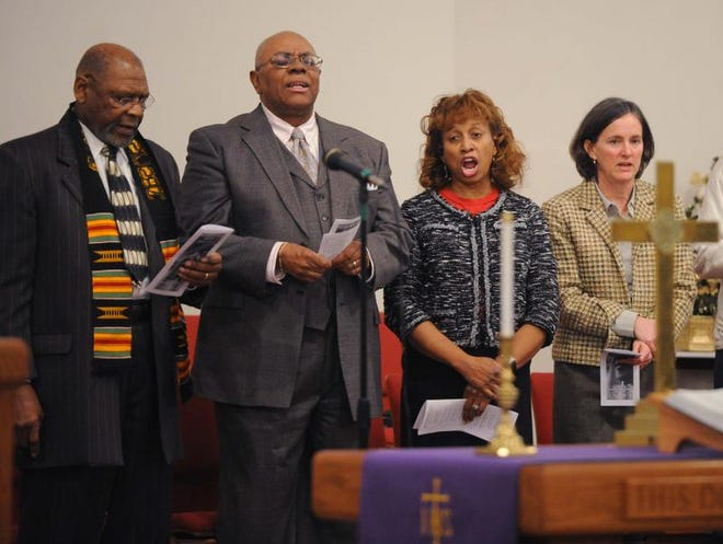 Former South African president Nelson Mandela was remembered Sunday at Scott United Methodist Church. The Rev. Angelique Walker-Smith (second from right) reflected on his legacy.