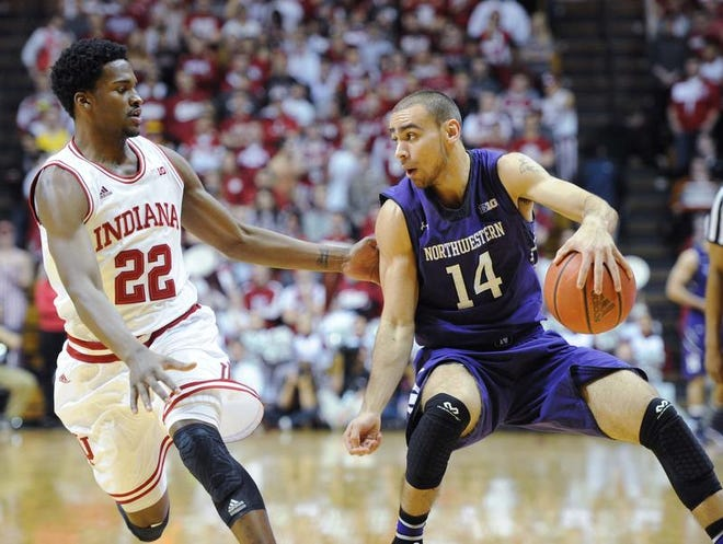Tre Demps works the ball around IU defender Stanford Robinson during the Hoosiers' loss Saturday at Assembly Hall.