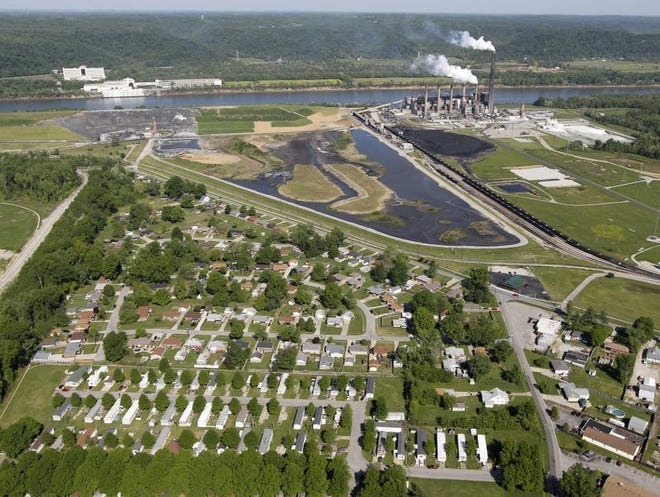LG&E's Cane Run power plant, including a coal ash handling pond and coal combustion waste landfill, next to a residential neighborhood, in 2012. THE COURIER-JOURNAL