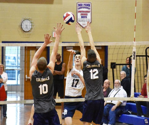 Chambersburg's Steven Swain gets a kill over two New Oxford defenders during a during a non-league boys volleyball game on Monday, May 8, 2017 in Chambersburg.