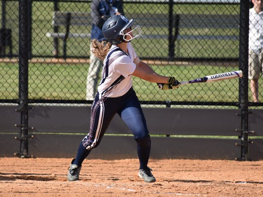Chambersburg's Kirsten Pugh gets a hit during a Mid