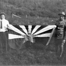May Hicks Curtis Hill (left) displays an early version (circa 1911) of what would become Arizona's state flag.