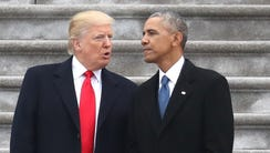 President Trump and former president Barack Obama exchange